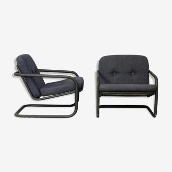 Pair of Prisunic edition armchairs, tubular steel and foam cushions, France, 1973