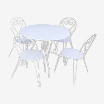 Salon de jardin 1 table 4 chaises en fer forgé blanc.