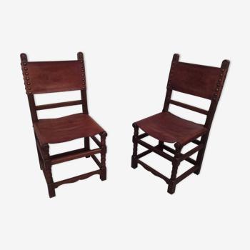 Paire de chaises en cuir épais et bois chêne