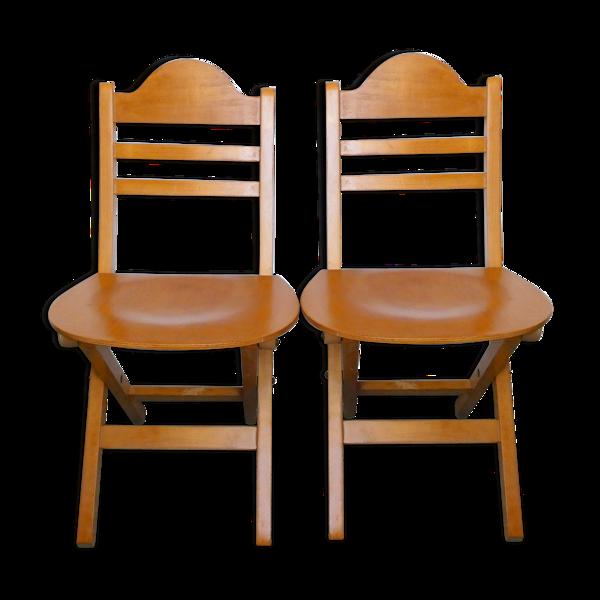 Paire de chaises pliantes en bois clair