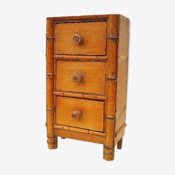 Former vintage bamboo doll dresser