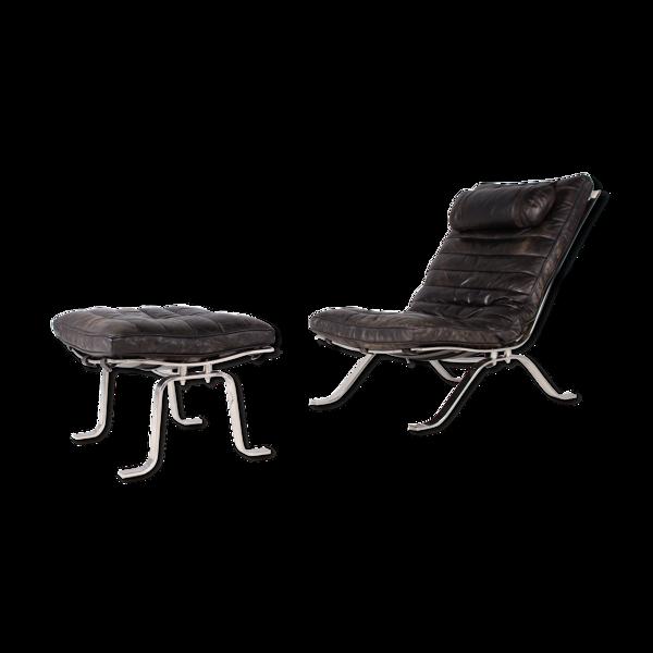 Fauteuil lounge en cuir et son ottoman