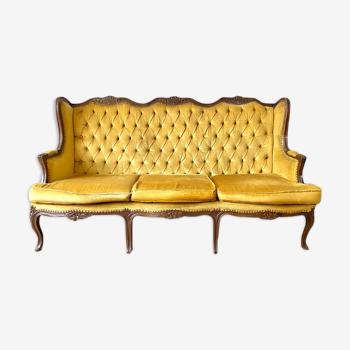 Canapé capitonné en velours vintage