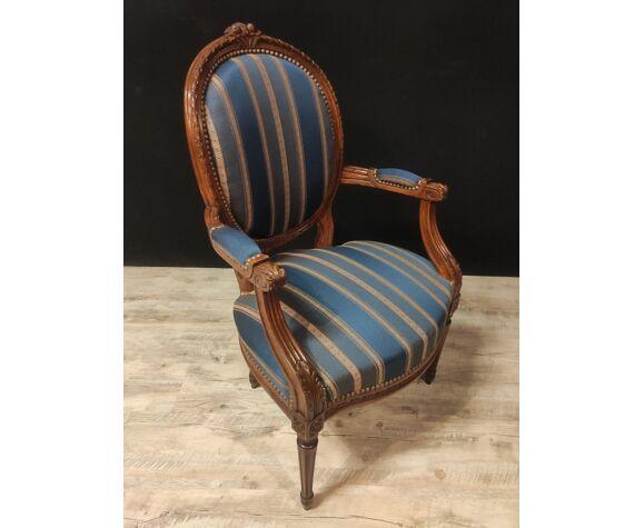 Suite de quatre fauteuils style Louis XVl