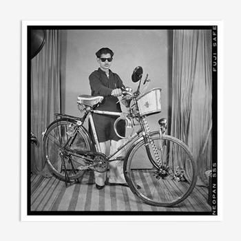 Photograph of an Indian posing with his bike