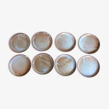 Série de 8 assiettes plates en grès