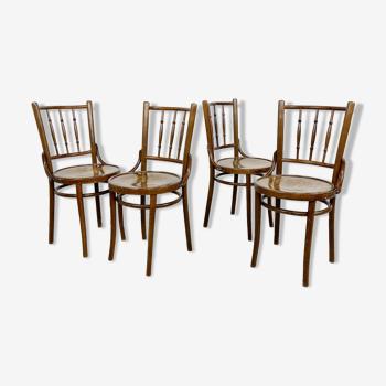Ensemble de quatre chaises en bois de bistrot de café de cru