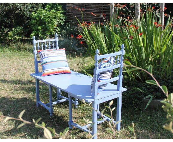Banc-chaises d'extérieur et 2 coussins