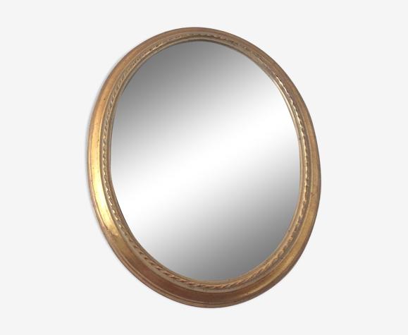 Ancien miroir ovale en bois doré