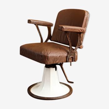 Fauteuil de coiffeur, début XXème, en fonte émaillée