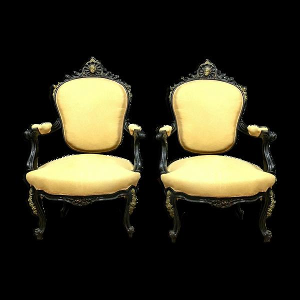 Paire de fauteuils époque Napoléon III en bois laqué noir et bronze patiné