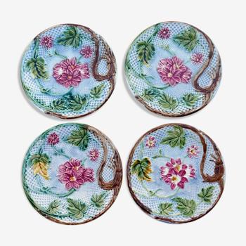 4 Asssiettes fleuries en barbotine anciennes