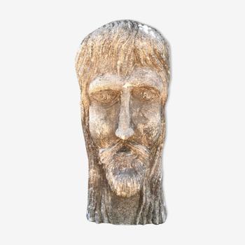 Tête sculptée en pierre du Gard