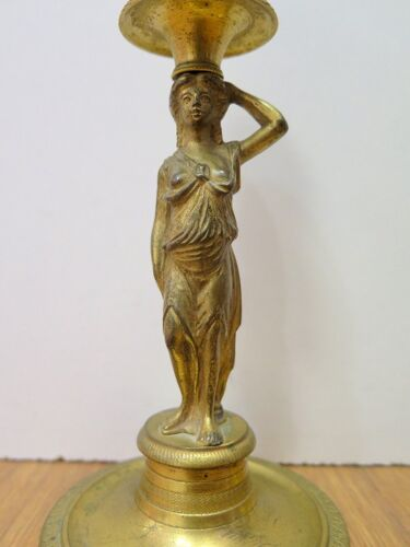 Paire de bougeoirs en bronze doré époque Empire