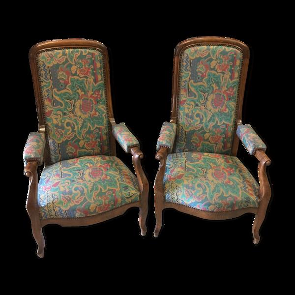 Paire de fauteuils Voltaire en noyer
