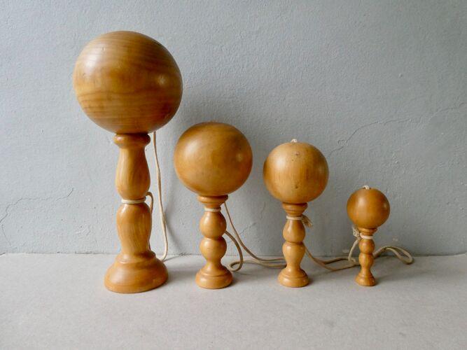 Set of 4 old light wood bilboquets