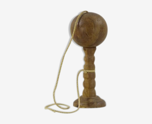 Old wooden bilboquet with its vintage cord