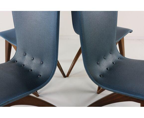 Quatre chaises originales en vinyle bleu  Van Os Swing