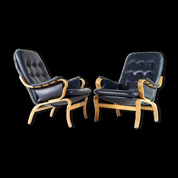 Paire de fauteuils de salon en cuir vintage des années 70
