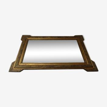 Miroir encadrement bois et stuc dorés début XXème 59x83cm