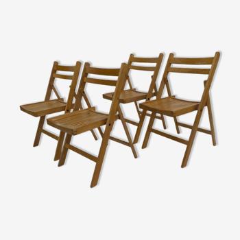 Ensemble de quatre chaises pliantes en bois vintage design design années 60
