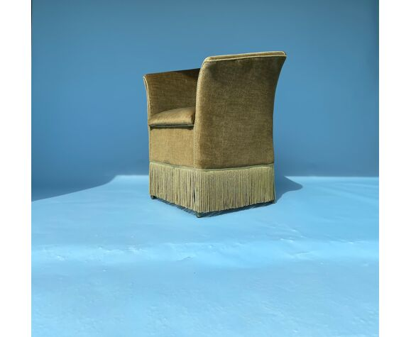 Olive green fringed armchair
