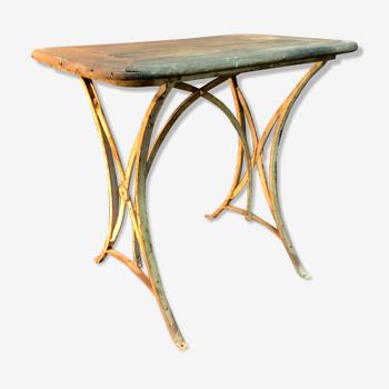 Ancienne table de jardin en fer forgé et bois