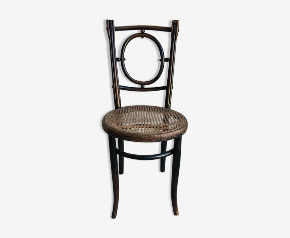Chaise bistrot  bois sculpté noir avec assise cannée vintage