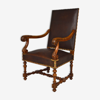 Louis XIII office armchair in leather and walnut carved around 1860