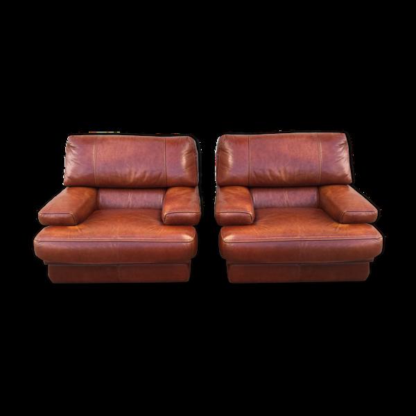 Lot de deux fauteuils cuir