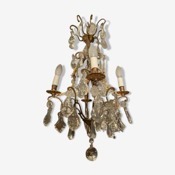 Lustre cage à pampilles de cristal sur monture en bronze style Louis XV