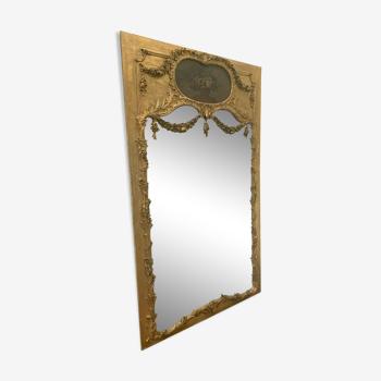 Miroir trumeau de style Louis XVI en bois et stuc doré XX siècle