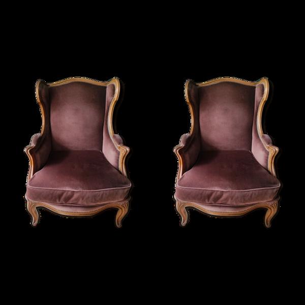 Paire de fauteuils à oreilles de style Louis XVI