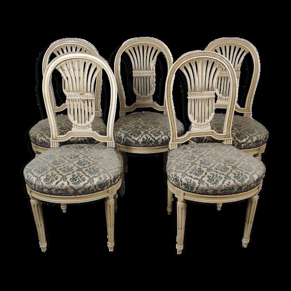 5 chaises en bois laqué blanc style Louis XVI