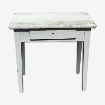 Small old white wooden table with a drawer