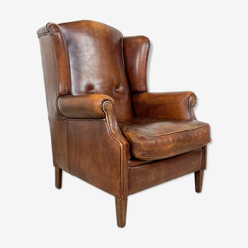 Vintage hand colored buttoned sheep leather wingback armchair