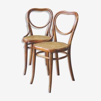 Lot de 2 chaises Thonet bistrot cœur n° 28 cannées, vers 1890