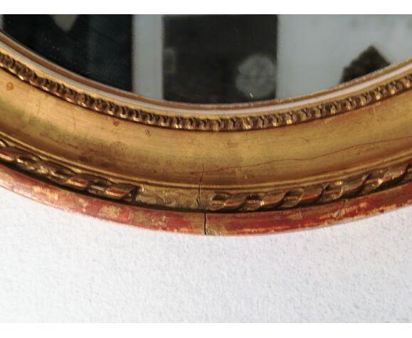 Miroir ovale style Louis XVI en bois doré 38cm