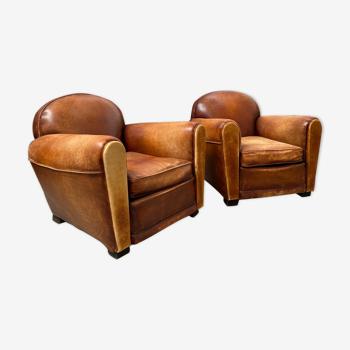 Paire de fauteuils « Club » années 50