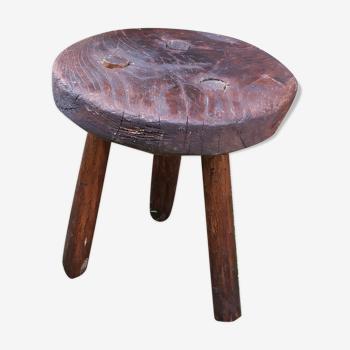 Tabouret tripode en bois brut