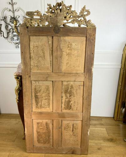 Miroir 18ème époque Louis XVI en bois doré sculpté 154x70cm