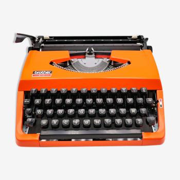 Machine à écrire brother 210 orange révisée avec ruban neuf