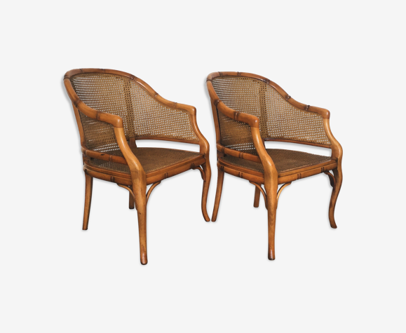 Pair of wooden and cannage armchairs
