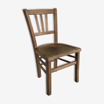 Chaise basse en bois vintage dite au coin du feu