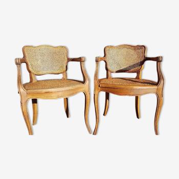 Paire de fauteuils cabriolets cannés de style Louis XV