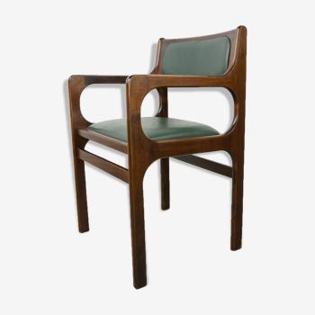 Fauteuil des années 60 en bois et simili cuir vert foncé