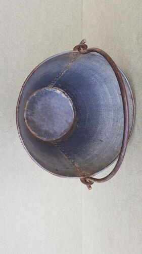 Old bucket with thick zinc handle