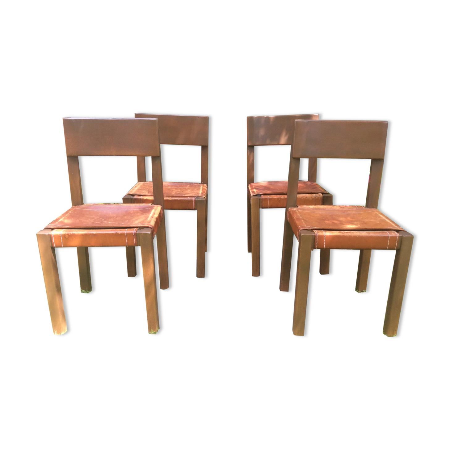 Série de 4 chaises vintage à piétement en orme et assises en cuir marron à la façon Pierre Chapo.