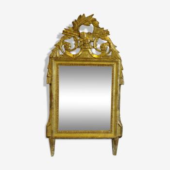Miroir Louis XVI en bois sculpté doré, H 75 cm