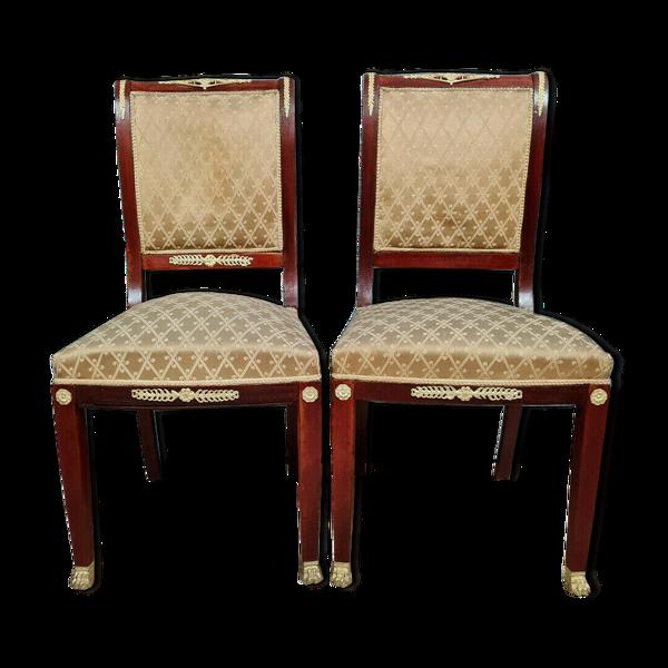 Paire de fauteuils Empire en acajou a cariatides avec tapisserie façon soie